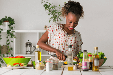 A woman cooking heart healthy food
